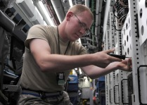 Senior Airman Ross Lemp, a 763rd Expeditionary Reconnaissance Squadron electronic warfare maintainer, performs routine maintenance onboard a RC-135V/W Rivet Joint May 6, 2013, at the 379th Air Expeditionary Wing. The RC-135's are primarily used as an intelligence, surveillance and reconnaissance platform; picking up real-time information on oppositional forces. Toy and Lemp are deployed from Offutt Air Force Base, Neb. (U.S. Air Force photo/Staff Sgt. Joel Mease)