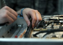 Electronic warfare maintainers from the 763rd Expeditionary Reconnaissance Squadron calibrate systems onboard a RC-135V/W Rivet Joint May 6, 2013, at the 379th Air Expeditionary Wing. The RC-135's are primarily used as an intelligence, surveillance and reconnaissance platform; picking up real-time information on oppositional forces. All RC-135s are assigned to Air Combat Command being permanently based at Offutt Air Force Base, Neb., using various forward deployment locations worldwide. (U.S. Air Force photo/Staff Sgt. Joel Mease)