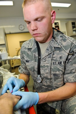 Airman 1st Class Joshua May, 379th Expeditionary Medical Operations Squadron medical technician, inserts an IV needle into a mock patient's vein as he practices his skills, May 9, 2013, at the 379th Air Expeditionary Wing's medical facility. May is deployed here from Joint Base Langley-Eustis, Va. The Air Force Medical Service celebrates Nurse and Medical Technician week May 6 - 12. (U.S. Air Force photo/Senior Airman Benjamin Stratton)