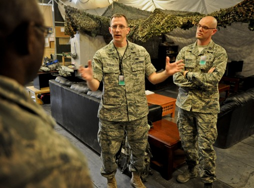 Chaplain (Capt.) David Dziolek visits with Airmen from the 379th Expeditionary Aircraft Maintenance Squadron, providing spiritual readiness May 16, 2013, at the 379th Air Expeditionary Wing in Southwest Asia. The maintenance group chaplain made a note to visit as many squadrons a week as he could during his tenure at the 379th. (U.S. Air Force photo/Senior Airman Benjamin Stratton)