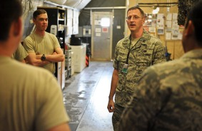 Chaplain (Capt.) David Dziolek visits with Airmen from the 379th Expeditionary Aircraft Maintenance Squadron, providing spiritual readiness May 16, 2013, at the 379th Air Expeditionary Wing in Southwest Asia. The chaplain began his career as an enlisted F-15E Strike Eagle mechanic. (U.S. Air Force photo/Senior Airman Benjamin Stratton)