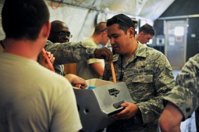 Staff Sgt. Bernard Untalan hands out popsicles to Airmen from the 379th Expeditionary Aircraft Maintenance Squadron, providing a refreshment and spiritual readiness May 16, 2013, at the 379th Air Expeditionary Wing in Southwest Asia. Untalan was Chaplain (Capt.) David Dziolek's chaplain assistant during their tenure at the 379th. (U.S. Air Force photo/Senior Airman Benjamin Stratton)