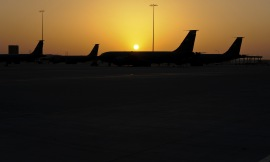 As the sunrises, KC-135 Stratotankers assigned to the 379th Air Expeditionary Wing, await their next mission within the area of operations May 18, 2013, in Southwest Asia. (U.S. Air Force photo/Senior Airman Benjamin Stratton)