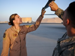 """Capt. Emma House and Staff Sgt. Ray Demarco perform pre-flight checks on aircraft """"57-1419,"""" May 18, 2013, at the 379th Air Expeditionary Wing in Southwest Asia. House is a 340th Expeditionary Air Refueling Squadron aircraft commander deployed from Scott Air Force Base, Ill., and Demarco is a 340th Aircraft Maintenance Unit crew chief deployed from the 108th Air National Guard Wing at McGuire AFB, N.J. Aircraft 57-1419 is a KC-135 Stratotanker deployed from the 190th Air Refueling Wing of the Kansas Air National Guard. (U.S. Air Force photo/Senior Airman Benjamin Stratton)"""