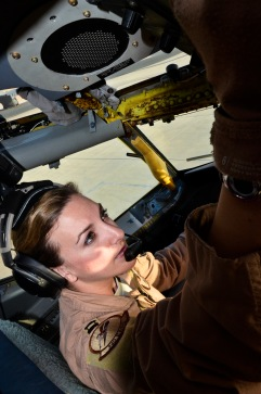 """Capt. Emma House performs pre-flight checks on aircraft """"57-1419,"""" May 18, 2013, at the 379th Air Expeditionary Wing in Southwest Asia. House is a 340th Expeditionary Air Refueling Squadron aircraft commander deployed from Scott Air Force Base, Ill. Aircraft 57-1419 is a KC-135 Stratotanker deployed from the 190th Air Refueling Wing of the Kansas Air National Guard. (U.S. Air Force photo/Senior Airman Benjamin Stratton)"""
