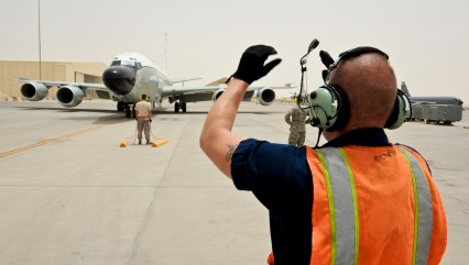 Airmen from the 763rd Aircraft Maintenance Unit prepare for the arrival of a RC-135 Rivet Joint after returning from a mission May 22, 2013, at the 379th Air Expeditionary Wing in Southwest Asia. (U.S. Air Force photo/Senior Airman Benjamin Stratton)