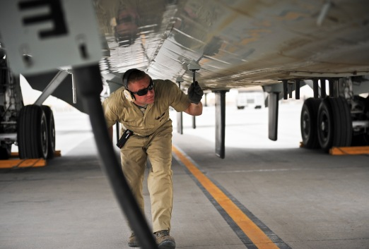 Staff Sgt. Jeffery DeHaan completes post-flight maintenance checks for a recently arrived RC-135 Rivet Joint May 22, 2013, at the 379th Air Expeditionary Wing in Southwest Asia. Brushel is a 763rd Aircraft Maintenance Unit crew chief deployed from Offutt Air Force Base, Neb. (U.S. Air Force photo/Senior Airman Benjamin Stratton)
