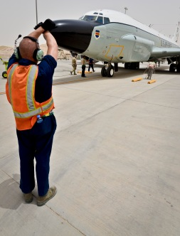 Staff Sgt. Robert Brushel directs a RC-135 Rivet Joint to its parking location after returning from a mission May 22, 2013, at the 379th Air Expeditionary Wing in Southwest Asia. Brushel is a 763rd Aircraft Maintenance Unit crew chief deployed from Offutt Air Force Base, Neb. (U.S. Air Force photo/Senior Airman Benjamin Stratton)