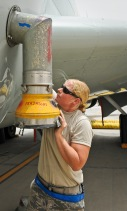 Staff Sgt. Stephanie Wang connects an air conditioning tube attachment to a recently arrived RC-135 Rivet Joint May 22, 2013, at the 379th Air Expeditionary Wing in Southwest Asia. Wang is a 763rd Aircraft Maintenance Unit electrician deployed from Offutt Air Force Base, Neb. (U.S. Air Force photo/Senior Airman Benjamin Stratton)