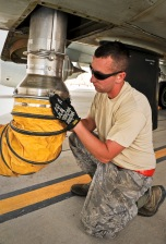 Staff Sgt. Cody Meyers connects an air conditioning tube attachment to a recently arrived RC-135 Rivet Joint May 22, 2013, at the 379th Air Expeditionary Wing in Southwest Asia. Meyers is a 763rd Aircraft Maintenance Unit hydraulics craftsman deployed from Offutt Air Force Base, Neb. (U.S. Air Force photo/Senior Airman Benjamin Stratton)
