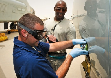 Staff Sgts. Tyler Wyatt and Wendell Parks service the engine oil during post-flight maintenance for a recently arrived RC-135 Rivet Joint May 22, 2013, at the 379th Air Expeditionary Wing in Southwest Asia. Wyatt and Parks are 763rd Aircraft Maintenance Unit jet engine mechanics deployed from Offutt Air Force Base, Neb. (U.S. Air Force photo/Senior Airman Benjamin Stratton)