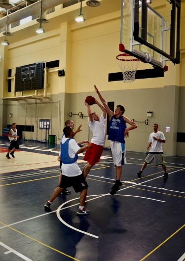 Tech. Sgt. Michael Sequin attempts a layup during a basketball game at a local school's annual military appreciation day, May 25, 2013, in Southwest Asia. Sequin is the 763rd Expeditionary Reconnaissance Squadron electronic warfare maintenance NCO in charge and deployed from Offutt Air Force Base, Neb. (U.S. Air Force photo/Senior Airman Benjamin Stratton)