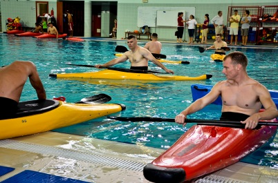 Servicemembers from the 379th Air Expeditionary Wing learn how to kayak at a local school's annual military appreciation day, May 25, 2013, in Southwest Asia. This annual military appreciation day was for servicemembers to get away from the wartime operational environment of the base and spend some time relaxing. (U.S. Air Force photo/Senior Airman Benjamin Stratton)
