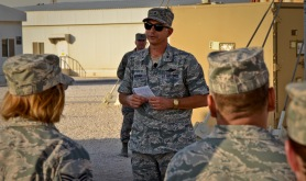Brig. Gen. Roger H. Watkins addresses U.S. and coalition forces deployed to the 379th Air Expeditionary Wing during a Memorial Day retreat ceremony, May 27, 2013, at Memorial Plaza in Southwest Asia. Watkins is the 379th AEW commander. (U.S. Air Force photo/Senior Airman Benjamin Stratton)