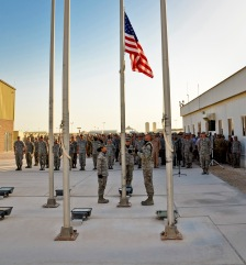 Honor guard members deployed to the 379th Air Expeditionary Wing attend to the colors during a Memorial Day retreat ceremony, May 27, 2013, at Memorial Plaza in Southwest Asia. Military retreat ceremonies serve a twofold purpose: to signal the end of the official duty day and to pay respect to the U.S. flag. (U.S. Air Force photo/Senior Airman Benjamin Stratton)