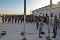 U.S. and coalition forces deployed to the 379th Air Expeditionary Wing salute the American flag during a Memorial Day retreat ceremony, May 27, 2013, at Memorial Plaza in Southwest Asia. Military retreat ceremonies serve a twofold purpose: to signal the end of the official duty day and to pay respect to the U.S. flag. (U.S. Air Force photo/Senior Airman Benjamin Stratton)