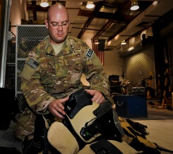 Staff Sgt. Joel Calahan inspects the battery pack of an explosive ordnance disposal bomb suit, May 29, 2013, at the 379th Air Expeditionary Wing in Southwest Asia. Calahan is a 379th Expeditionary Civil Engineer Squadron EOD craftsman deployed from Nellis Air Force Base, Nev. (U.S. Air Force photo/Senior Airman Benjamin Stratton)