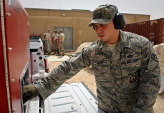 Staff Sgt. Kristopher Jaime operates the water tank and pump generator during training on the PyroLance, June 4, 2013, at the 379th Air Expeditionary Wing in Southwest Asia. This tool gives crews access to engine bays, cabins, cargo holds or anywhere else fire breaks out. Jaime is a 379th Expeditionary Civil Engineer Squadron firefighter. (U.S. Air Force photo/Senior Airman Benjamin Stratton)