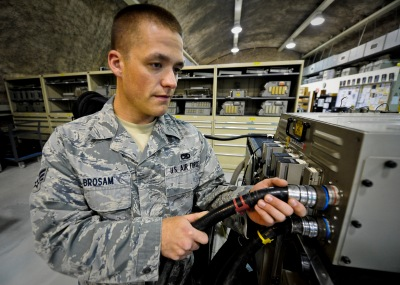 Senior Airman Scott Brosam attaches the input power for running the F-15 Strike Eagle multi-purpose display, June 5, 2013, at the 379th Air Expeditionary Wing in Southwest Asia. Brosam is a 379th Expeditionary Maintenance Squadron F-15 avionics technician deployed from Mountain Home Air Force Base, Idaho. (U.S. Air Force photo/Senior Airman Benjamin Stratton)