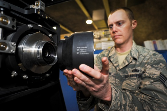 Staff Sgt. Jesse Thorn sets up a C-17 Globemaster III display unit for calibration, June 5, 2013, at the 379th Air Expeditionary Wing in Southwest Asia. This process allows technicians to adjust the airframe's heads-up display for brightness and positional alignment. Thorn is a 379th Expeditionary Maintenance Squadron C-17 avionics technician deployed from Joint Base Lewis-McChord, Wash. (U.S. Air Force photo/Senior Airman Benjamin Stratton)