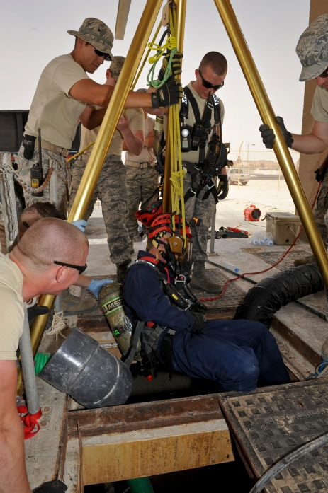 Airman 1st Class Devin Walsh is lowered into one of the installation's largest sewage lift stations to repair a pump at the 379th Air Expeditionary Wing in Southwest Asia, June 18, 2013. Walsh is a 379th Expeditionary Civil Engineer Squadron water and fuel systems maintenance technician deployed from Elmendorf AFB, Alaska. (U.S. Air Force photo/Senior Airman Benjamin Stratton)