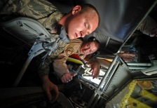 Staff Sgt. Samuel Martinez shows Cadet Aubry Eaton how to operate the boom controls on board a KC-135 Stratotanker at the 379th Air Expeditionary Wing in Southwest Asia, June 24, 2013. Martinez is a 340th Expeditionary Air Refueling Squadron boom operator deployed from McConnell Air Force Base, Kan. More than 40 U.S. Air Force Academy cadets visited the 379th AEW in June observing deployed operations first-hand and interacting with deployed U.S. and coalition forces. (U.S. Air Force photo/Senior Airman Benjamin Stratton)