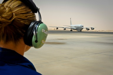 Staff Sgt. Seren Aydemir prepares to 'catch' an E-8C Joint Surveillance Target Attack Radar System as it returns from a mission at the 379th Air Expeditionary Wing in Southwest Asia, June 28, 2013. Joint STARS is capable of determining the direction, speed and patterns of military activity of ground vehicles and helicopters. Aydemir is a 7th Expeditionary Aircraft Maintenance Unit instruments and flight control journeyman deployed from Robins Air Force Base, Ga. (U.S. Air Force photo/Senior Airman Benjamin Stratton)