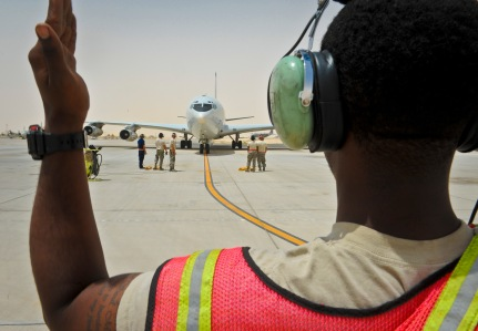 Senior Airman Jamison Johnson marshals an E-8C Joint Surveillance Target Attack Radar System as the jet returns from a mission at the 379th Air Expeditionary Wing in Southwest Asia, June 28, 2013. Joint STARS were first deployed in Operation DESERT STORM in 1991, and have since been deployed in support of various operations around the globe including ongoing operations in Afghanistan. Johnson is a 7th Expeditionary Aircraft Maintenance Unit crew chief deployed from Robins Air Force Base, Ga. (U.S. Air Force photo/Senior Airman Benjamin Stratton)