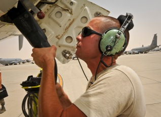 Staff Sgt. Justin Wood connects a ground power cable to an E-8C Joint Surveillance Target Attack Radar System immediately after the jet returned from a mission at the 379th Air Expeditionary Wing in Southwest Asia, June 28, 2013. This connection provides ground power so the maintainers can prepare the aircraft for the next mission. Wood is a 7th Expeditionary Aircraft Maintenance Unit electro-environmental specialist deployed from Robins Air Force Base, Ga. (U.S. Air Force photo/Senior Airman Benjamin Stratton)