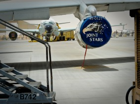 An E-8C Joint Surveillance Target Attack Radar System sits adjacent to sister-airframe, RC-135 Rivet Joint, as they await their next mission at the 379th Air Expeditionary Wing in Southwest Asia, June 28, 2013. Joint STARS provides ground situation information through communication via secure data links with Air Force command posts, Army mobile ground stations and centers of military analysis. (U.S. Air Force photo/Senior Airman Benjamin Stratton)
