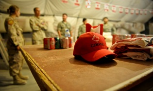 With Canadian flags strung from corner to corner, maple syrup candies on every table, and Canadian paraphernalia at every turn, Canadian, U.S., Australian, coalition and mission partners celebrated Canada's birthday July 1, 2013, at the 379th Air Expeditionary Wing in Southwest Asia. The evening's activities ranged from a Canadian trivia game to a guitar solo to board games. (U.S. Air Force photo/Senior Airman Benjamin Stratton)