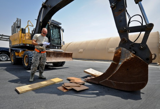 Staff Sgt. Adam Rozehnal checks to make sure an excavator has the proper blocking before it is loaded onto a C-17 Globemaster III at the 379th Air Expeditionary Wing in Southwest Asia, July 17, 2013. Rozehnal is an 8th Expeditionary Air Mobility Squadron air transportation supervisor deployed from Joint Base McGuire-Dix-Lakehurst, N.J. (U.S. Air Force photo/Senior Airman Benjamin Stratton)
