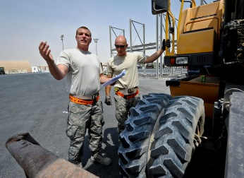 Senior Airman Jeffrey Montgomery and Staff Sgt. Adam Rozehnal check to make sure an excavator has the proper documentation and hazardous materials are stored correctly before it is loaded onto a C-17 Globemaster III at the 379th Air Expeditionary Wing in Southwest Asia, July 17, 2013. Montgomery is an 8th Expeditionary Air Mobility Squadron air transportation technician deployed from Joint Base Charleston, S.C., and Rozehnal is an 8th EAMS air transportation supervisor deployed from Joint Base McGuire-Dix-Lakehurst, N.J. (U.S. Air Force photo/Senior Airman Benjamin Stratton)