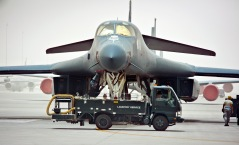 """Airmen from the 8th Expeditionary Air Mobility Squadron fleet services remove waste from a 34th Expeditionary Bomb Squadron B-1B Lancer at the 379th Air Expeditionary Wing in Southwest Asia, June 11, 2013. Once an aircraft comes to the flightline, the lavatory service truck goes out to the aircraft and attaches a pipe to the plane with what they call the """"moose head"""" for a nozzle. A handle is pulled releasing the waste which then flows through the pipe and into the truck. Not only do these Airmen care for Air Mobility Command aircraft, but are the only fleet services unit in the U.S. Central Command's area of responsibility taking care of any aircraft transiting through the 379th AEW. (U.S. Air Force photo/Senior Airman Benjamin Stratton)"""