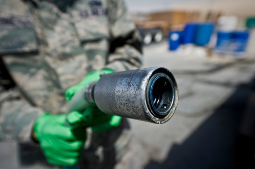 Tech. Sgt. Christopher Breski inspects a hose used by the lavatory service truck during aircraft waste recovery at the 379th Air Expeditionary Wing in Southwest Asia, July 22, 2013. Breski is the 8th Expeditionary Air Mobility Squadron fleet services NCO in charge deployed from Joint Base McGuire-Dix-Lakehurst, N.J. (U.S. Air Force photo/Senior Airman Benjamin Stratton)