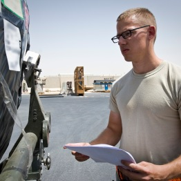 Senior Airman Sean Bryant inspects cargo and its paperwork at the 379th Air Expeditionary Wing in Southwest Asia, July 22, 2013. Bryant is an 8th Expeditionary Air Mobility Squadron special handling technician deployed from Joint Base McGuire-Dix-Lakehurst, N.J. (U.S. Air Force photo/Senior Airman Benjamin Stratton)