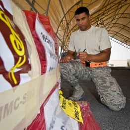 Airman 1st Class Gavin Marsh inspects specially labeled cargo at the 379th Air Expeditionary Wing in Southwest Asia, July 22, 2013. Marsh is an 8th Expeditionary Air Mobility Squadron cargo processing specialist deployed from Joint Base McGuire-Dix-Lakehurst, N.J. (U.S. Air Force photo/Senior Airman Benjamin Stratton)