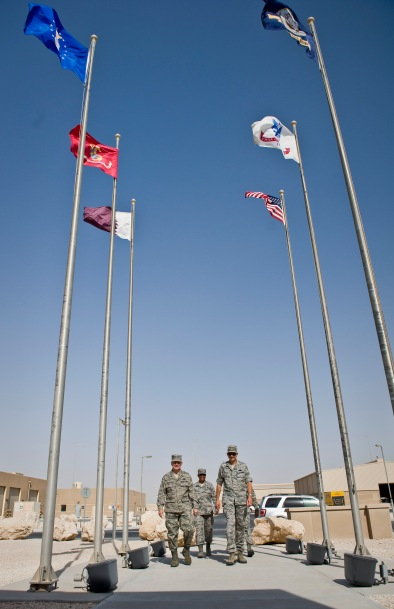 Lt. Gen. John W. Hesterman III walks with Brig. Gen. Roger H. Watkins and Chief Master Sgts. Shelina Frey and Rory Wicks as they enter the Wing Operations Center at the beginning of Hesterman's tour at the 379th Air Expeditionary Wing in Southwest Asia, July 23, 2013. Hesterman is the Combined Force Air Component Commander, Watkins is the 379th AEW commander, Frey is the U.S. Air Forces Central Command command chief and Wicks is the 379th AEW command chief. (U.S. Air Force photo/Senior Airman Benjamin Stratton)