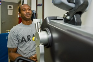U.S. Army Spc. Demetrius Payton warms up his muscles prior to physical therapy at the 379th Air Expeditionary Wing in Southwest Asia, July 24, 2013. Payton is a motor vehicle operator who injured himself during convoy operations in Afghanistan and has been recovering at the Intra-Theater Care Program here. (U.S. Air Force photo/Senior Airman Benjamin Stratton)