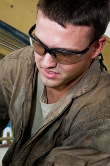 Airman 1st Class Tyler Jones performs routine maintenance on an aircraft cargo loader at the 379th Air Expeditionary Wing in Southwest Asia, July 31, 2013. Jones is a 379th Expeditionary Logistics Readiness Squadron vehicle mechanic deployed from Eielson Air Force Base, Alaska. (U.S. Air Force photo/Senior Airman Benjamin Stratton)