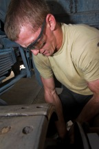 Senior Airman Dustin Franklin works on the brakes of a shuttle bus at the 379th Air Expeditionary Wing in Southwest Asia, July 31, 2013. Franklin is a 379th Expeditionary Logistics Readiness Squadron vehicle mechanic deployed from Eglin Air Force Base, Fla. (U.S. Air Force photo/Senior Airman Benjamin Stratton)