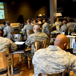 Grand Slam Airmen watch an Article 15 process video with discussions lead by Master Sgt. Melissa Somers during a First Sergeant Symposium at the 379th Air Expeditionary Wing in Southwest Asia, Aug. 8, 2013. The two-day course was designed to provide information and tools to aspiring first sergeants. Somers is the 379th Expeditionary Civil Engineer Squadron first sergeant deployed from Fairchild Air Force Base, Wash., and a course instructor. (U.S. Air Force photo/Senior Airman Benjamin Stratton)