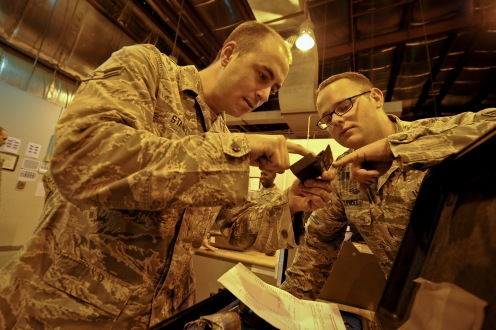 Airman 1st Class Steven Stanfa and Senior Airman Tim Zuendel inspect a tool's coding as Stanfa returns a tool kit to the consolidated tool kit at the 379th Air Expeditionary Wing in Southwest Asia, Aug. 8, 2013. Stanfa is an 8th Expeditionary Air Mobility Squadron CTK debriefer deployed from Joint Base Lewis-McChord, Wash., and hails from Rock Island, Tenn. Zuendel is an 8th EAMS CTK custodian deployed from Travis Air Force Base, Calif., and hails from Maine, N.Y. (U.S. Air Force photo/Senior Airman Benjamin Stratton)