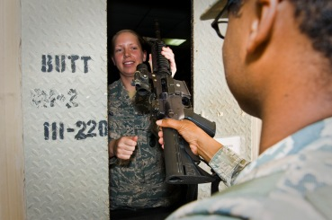 Airman 1st Class Jillian Ward issues an M4 carbine assault rifle to Senior Airman Thomas Flowers at the 379th Air Expeditionary Wing in Southwest Asia, Aug. 14, 2013. Ward is a 379th Expeditionary Security Forces Squadron staff armorer deployed from Mountain Home Air Force Base, Idaho, and hails from Sunbury, Ohio. Flowers is a 379th ESFS security forces leader deployed from Royal Air Force Lakenheath, England, and a Washington, D.C., native. (U.S. Air Force photo/Senior Airman Benjamin Stratton)