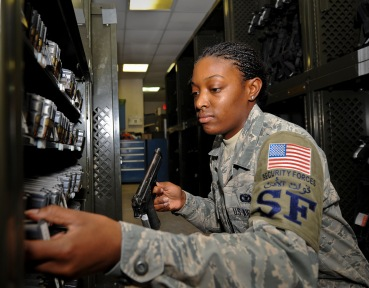 Senior Airman Jamela Nuriddin inventories ammunition and weapons at the 379th Air Expeditionary Wing in Southwest Asia, Aug. 14, 2013. Nuriddin is a 379th Expeditionary Security Forces Squadron staff armorer deployed from Seymour Johnson Air Force Base, N.C., and a Raleigh, N.C., native. (U.S. Air Force photo/Senior Airman Benjamin Stratton)