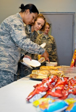 Senior Airman Vikki Flores and Lt. Col. Sirena Morris select which sandwich to eat during the Women's Equality Day celebration at the 379th Air Expeditionary Wing in Southwest Asia, Aug. 26, 2013. Flores is a 379th Expeditionary Civil Engineer Squadron emergency management journeyman deployed from Dover Air Force Base, Del., and an Azusa, Calif., native. Morris is the 379th Expeditionary Force Support Squadron commander and a Fayetteville, N.C., native. (U.S. Air Force photo/Senior Airman Benjamin Stratton)