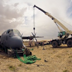 Airmen forward deployed from the 379th Air Expeditionary Wing assist in a crash damage reclamation and demilitarization project of a C-130J Super Hercules at a forward operating base in Afghanistan, July 1, 2013. The team recovered 250 components totaling more than $20 million. (U.S. Air Force photo)