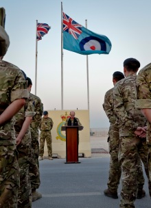 Royal Air Force service members bow their heads as Reverend (Sqdn. Leader) Andrew Wakeham-Dawson leads the group in prayer during the Battle of Britain Day parade ceremony at the 379th Air Expeditionary Wing in Southwest Asia, Sept. 20, 2013. The RAF holds this day special as it was the day the Luftwaffe embarked on their largest bombing attack yet, forcing the engagement of the entire RAF Fighter Command in defense of London and the South East, which resulted in a decisive victory in favor of Britain and marked a turning point in the war. (U.S. Air Force photo/Staff Sgt. Benjamin W. Stratton)