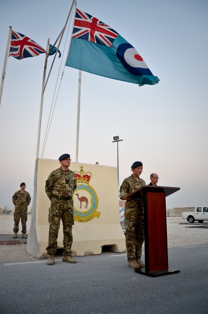 "Flight Lt. Claire Wells addresses those in attendance during the Battle of Britain Day parade ceremony at the 379th Air Expeditionary Wing in Southwest Asia, Sept. 20, 2013. Winston Churchill summed up the effect of the battle and the contribution of Fighter Command with the words, ""Never in the field of human conflict was so much owed by so many to so few."" Pilots who fought in the battle have been known as 'The Few' ever since. Wells is an 83 Expeditionary Air Group detachment administration officer. (U.S. Air Force photo/Staff Sgt. Benjamin W. Stratton)"