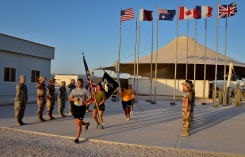 Service members from the U.S. Army, Marine Corps, Navy and Air Force complete the 24-hour prisoners of war and missing in action vigil run as U.S. military, coalition and mission partners render salutes at the 379th Air Expeditionary Wing in Southwest Asia, Sept. 21, 2013. The run began Sept. 20 and culminated with a closing ceremony and traditional flag folding by the base honor guard in reverence to those still missing. (U.S. Air Force photo/Staff Sgt. Benjamin W. Stratton)